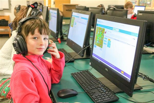 A third-grade girl works on a Minecraft project during a computer coding lesson in the Fairley computer lab.