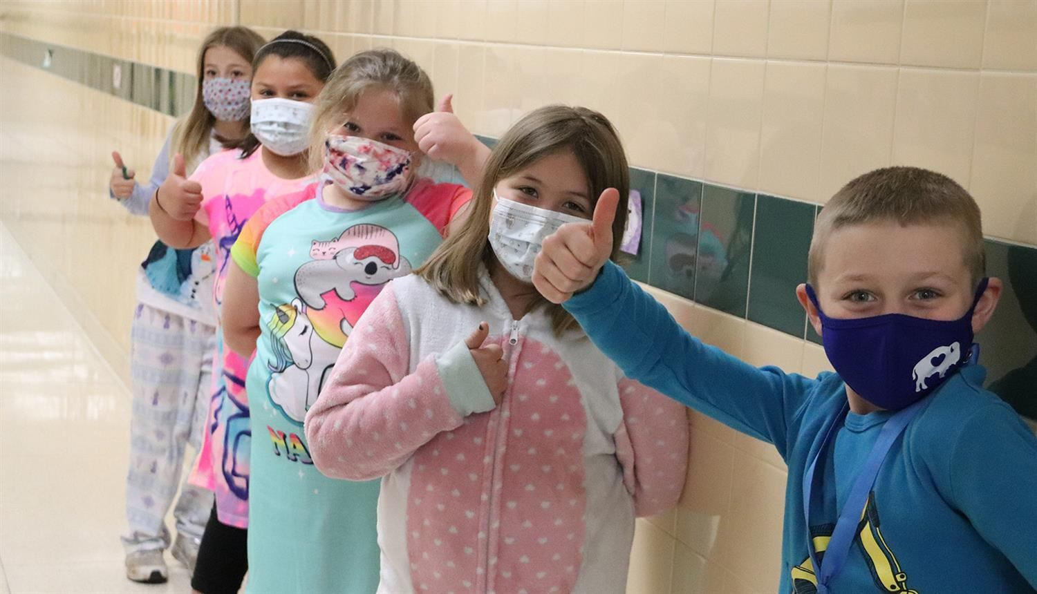 Fairley students give the thumbs up as they show off the PJs they wore