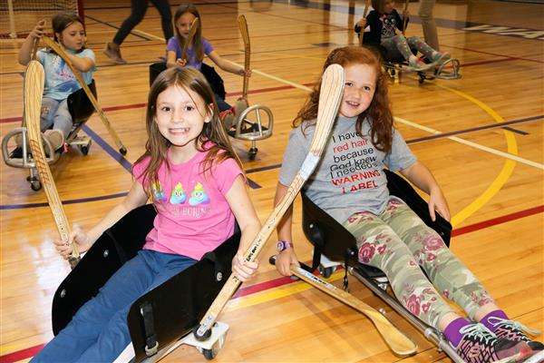 Fairley students try playing sled hockey during a visit from Move Along Inc.
