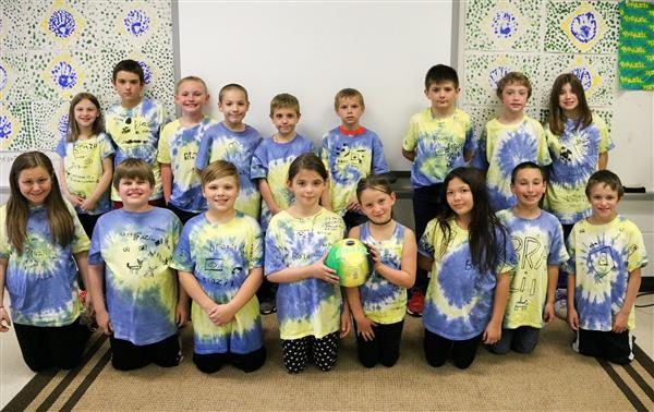 Third-graders from Jodi Kraeger's classroom sport their Brazil T-shirts in a class photo